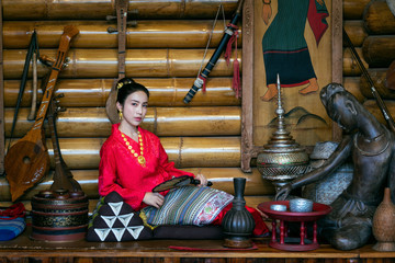 Wall Mural - Asian women wearing Thai dress costume traditional according Thai culture and tradition.