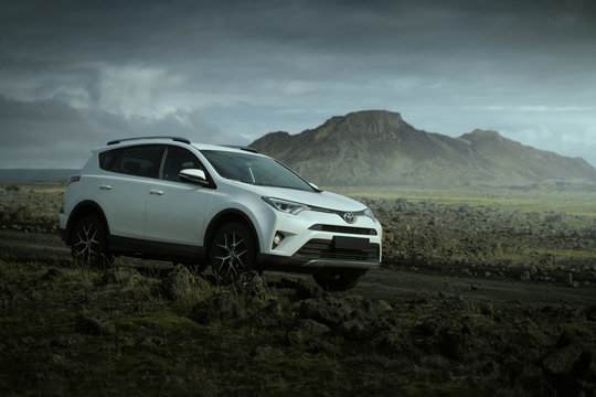 Southern Region, Iceland - September 9, 2019: White car Toyota RAV4 is parked at countryside off road in Southern Region, Iceland. Rental car