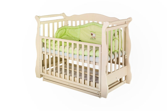 Wooden crib isolated on a white background