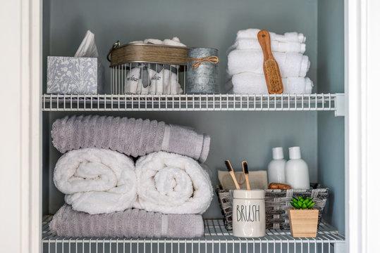 Neatly organized bathroom linen closet