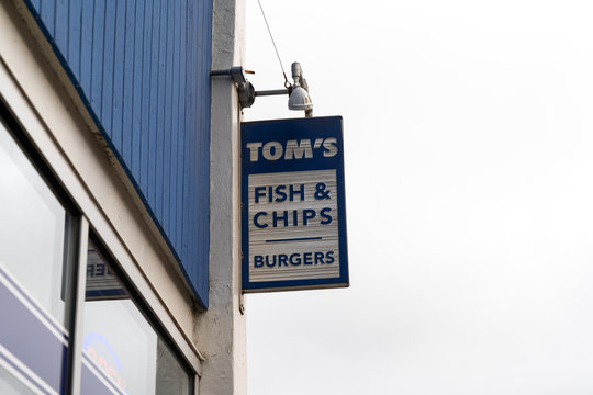 Seaside, Oregon - July 31, 2020: Sign for Toms Fish and Chips (and burgers) restaurant, located in downtown area