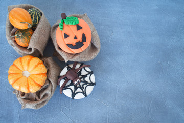 luxury pumpkins with cupcakes on grey background