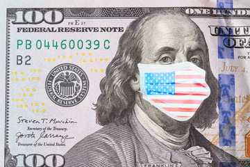 Benjamin Franklin masked in American flag colors on 100 dollar bill, isolated on white background. The concept of preventing money from the crisis.
