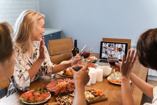 Cheerful happy friends having party via video call