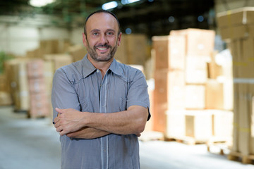 smiling man in a warehouse