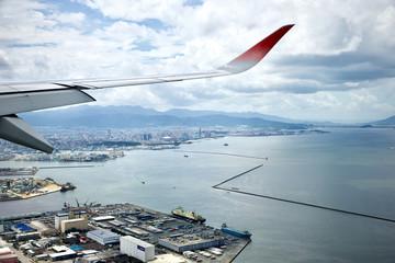 飛行機の窓から見た海 Fotobehang