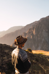 unrecognizable man taking photos in nature