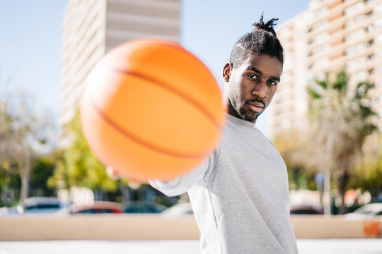 Basketball players standing on street playground