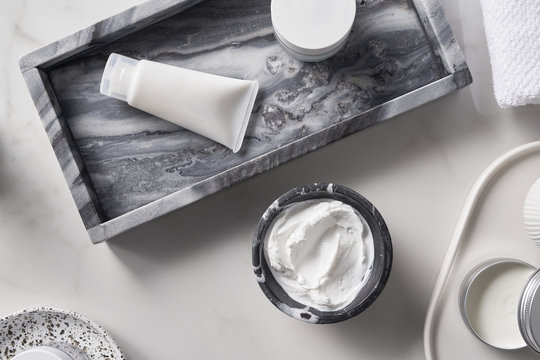 Skincare supplies composition on white table
