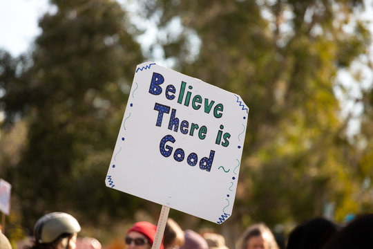 """Protest sign reading : """"""""Believe there is good"""""""""""