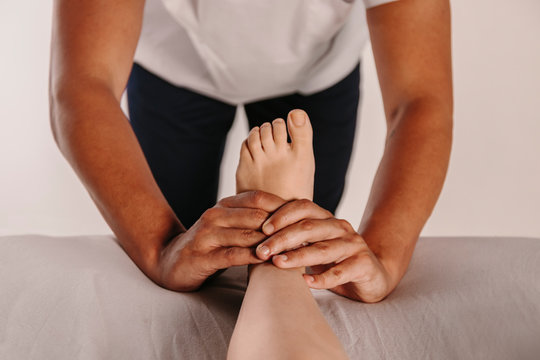 Physiotherapist giving a feet massage