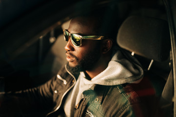 young african american man in the car .
