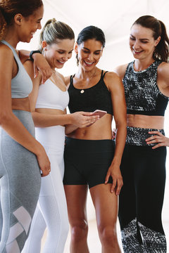 Fitness women looking at a smart phone
