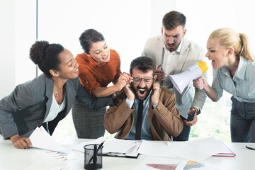 Colleagues criticizing boss for his wrong decision making