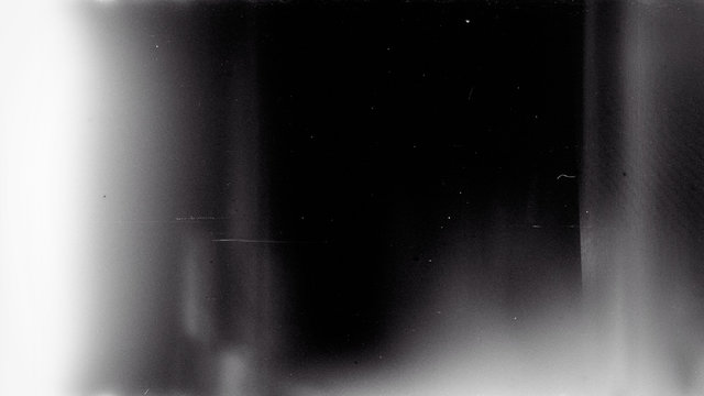Noisy film frame with heavy noise, dust and grain