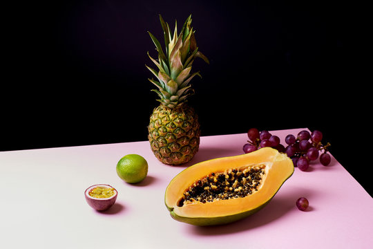 Tropical fruits still life with mango, papaya, pitahaya, passion fruit, grapes, lime and pineapple. Fruit plate