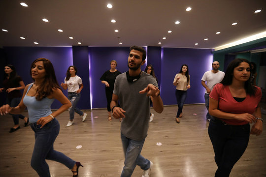 Salah Suqi Qasim, who is also a baker, teaches his students Salsa dance at Tempo Dance Academy in Amman