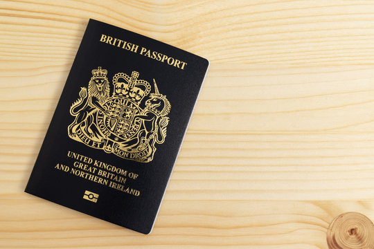 London, UNITED KINGDOM - AUGUST 17, 2020: New British Passport Edition released in March 2020 after Brexit laid on desk, citizenship newsworthy