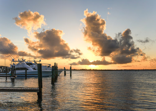 Sunset over Marina in Fort Pierce, Florida on the Indian River Lagoon near yacht club. Treasure Coast boating life. Scenic and tranquil golden hour on Hutchinson Island. Life in St. Lucie County, FL.