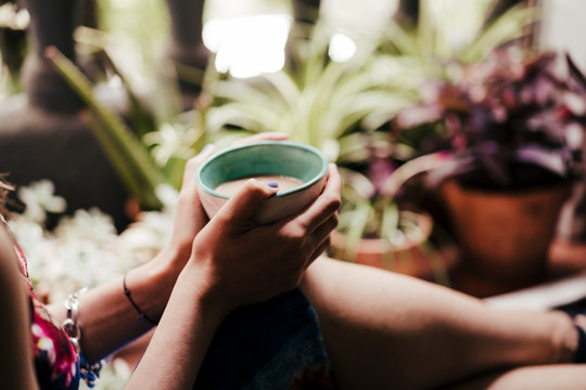 Close-up of woman's hands holding coffee cup