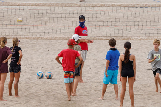 Kids attend a volleyball camp on the beach in California
