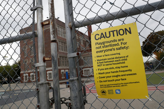 A sign is posted outside closed Public School 96 in New York