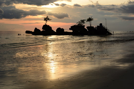 Sunset time at Willy Rock. White Beach. Boracay island. Western Visayas. Philippines