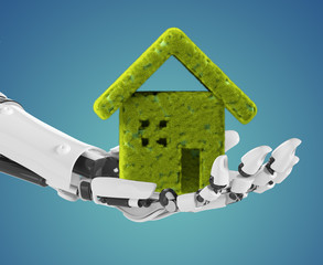 Robotic hand holding a green house