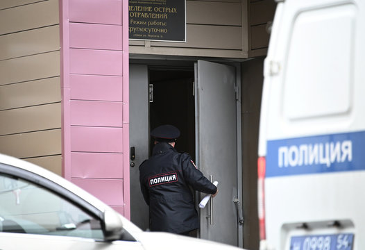 A police officer enters a building at a hospital where Russian opposition leader Navalny was admitted, in Omsk