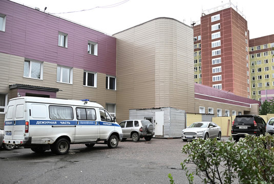 A police vehicle is seen parked outside a hospital where Russian opposition leader Navalny was admitted, in Omsk