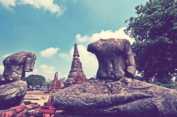 Ancient headless Buddha images in temple historical park in Thailand