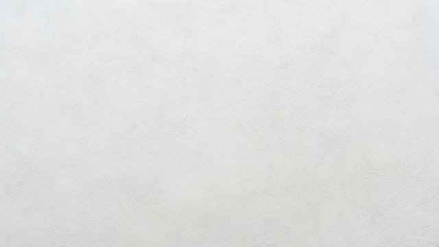 White plastered concrete wall background or texture