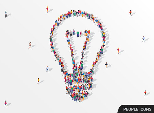 Large group of people seen from above gathered together in the shape of lightbulb. Idea and inspiration concept.