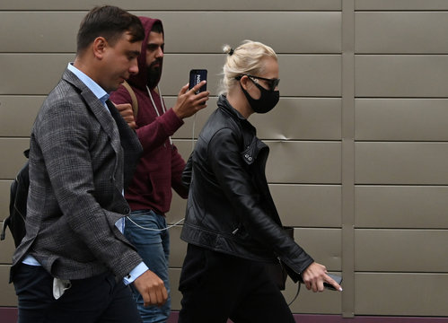 Yulia Navalnaya and Ivan Zhdanov arrive at a hospital where Russian opposition leader Alexei Navalny was admitted, in Omsk