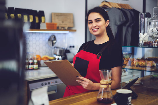 Smiling administrative manager counting annual income from service and sales