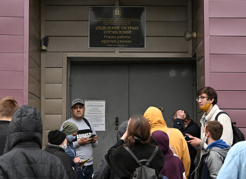People gather outside a hospital where Russian opposition leader Navalny was admitted, in Omsk