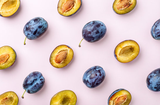 blue plums on pink background