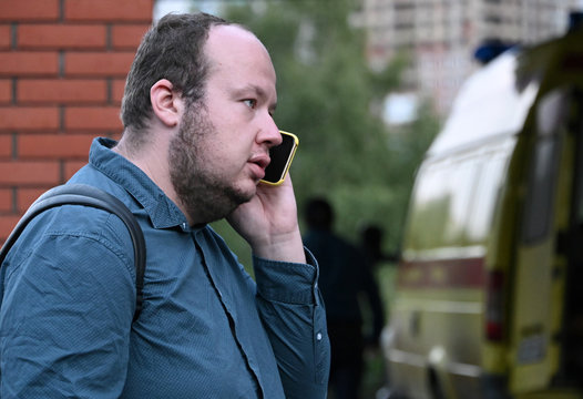 An employee of Anti-Corruption Foundation Alburov talks on his phone outside a hospital where Russian opposition leader Navalny was admitted, in Omsk