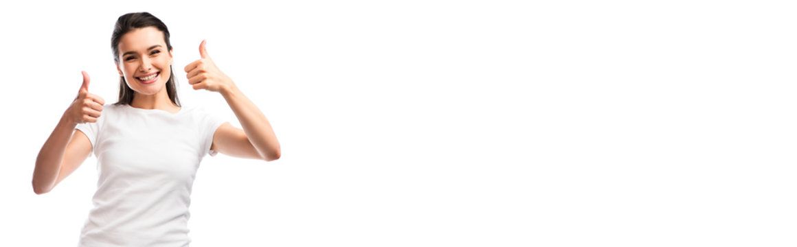 panoramic crop of young woman in white t-shirt showing thumbs up isolated on white