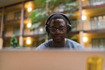 Young man wearing eyeglasses and headphones