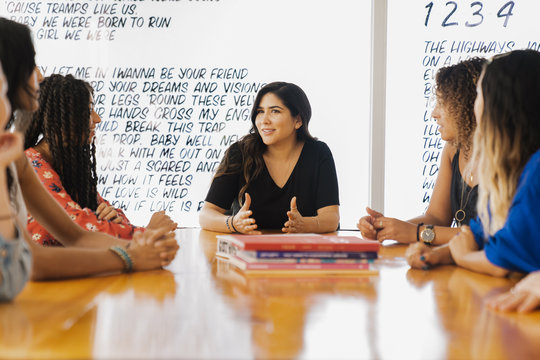 Businesswoman leading meeting at conference table