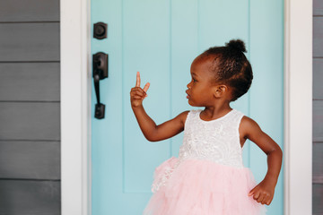Girl in tutu pointing her finger while standing outdoors