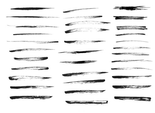 A set of art strokes in ink in monochrome style.