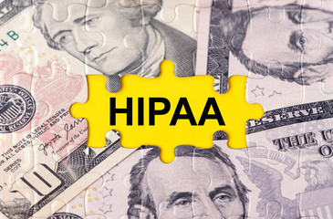 Puzzle with the image of dollars in the center of the inscription -HIPAA