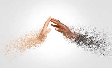 Hands of Caucasian woman and African-American man reaching out to each other on color background. Racism concept