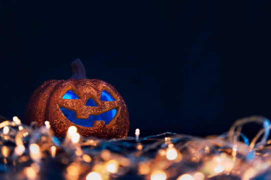 Halloween pumpkin Jack O Lanterns and bokeh lights on foreground with copy space. decoration for party - Halloween Background