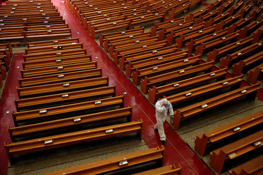 Member of a disinfection company sanitises the Yoido Full Gospel Church, which is the largest church in the country, in Seoul