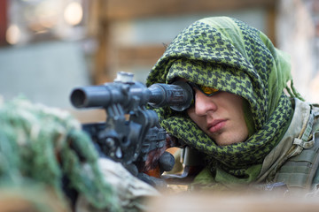 A sniper with an SVD sits on the roof. Safety and security. Airsoft game