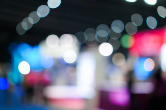 Light Bokeh Event exhibition business concept; Abstract blurred of defocused convention exhibit trade show and booth in conference hall background. backdrop with glitter sparkle blurred circles