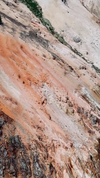 Abstract Red, Orange, and White Rocky Mountain Side